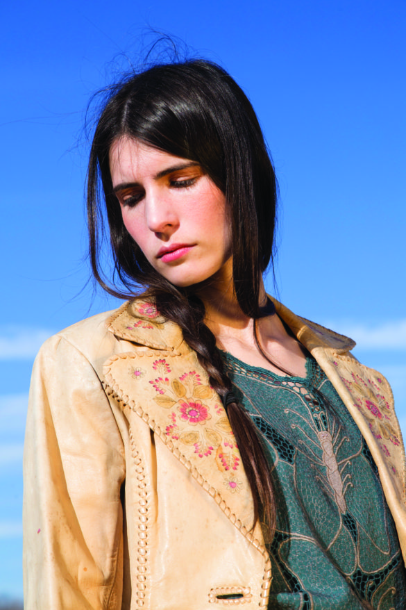 Vintage 1970s Char hand painted leather blazer atop a 1970s dusty teal cut out floral blouse by Laced With Romance